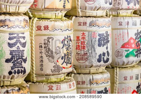 NIKKO, JAPAN - NOVEMBER 13, 2016 : Barrels of sake at Toshogu Temple take at Nikko World Heritage Site in Tochigi Japan. Japanese donate sake to the temples and shrines as offering for the Gods.