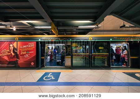 SAO PAULO BRAZIL - OCTOBER 12 2017: Front picture of the train with open doors at the platform of the metro station Paulista yellow line located in the city of Sao Paulo Brazil.