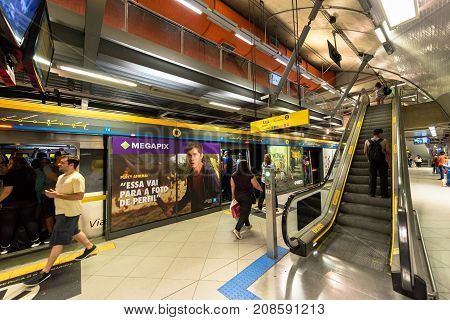 SAO PAULO BRAZIL - OCTOBER 12 2017: Wide angle picture of the train with open doors and stairs at the platform of the metro station Paulista yellow line located in the city of Sao Paulo Brazil.