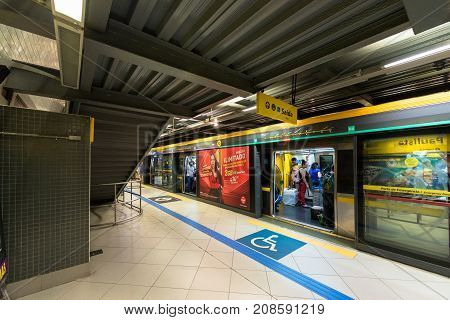 SAO PAULO BRAZIL - OCTOBER 12 2017: Wide angle picture of the train with open doors at the platform of the metro station Paulista yellow line located in the city of Sao Paulo Brazil.