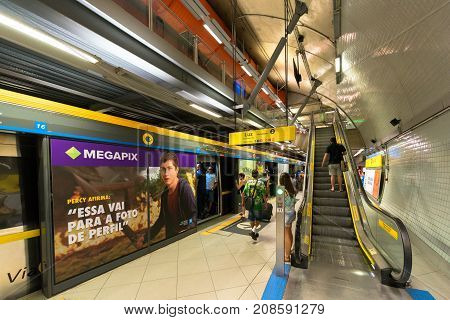 SAO PAULO BRAZIL - OCTOBER 12 2017: Horizontal picture of the train with open doors and stairs at the platform of the metro station Paulista yellow line located in the city of Sao Paulo Brazil.