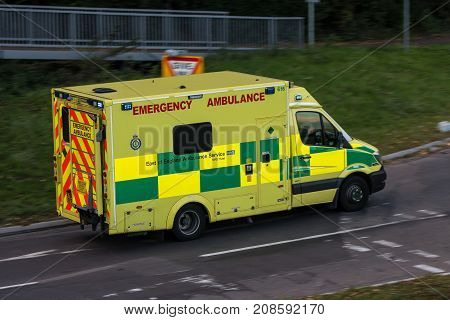 Watford UK - October 5 2017: Ambulance in rush on the street in the town