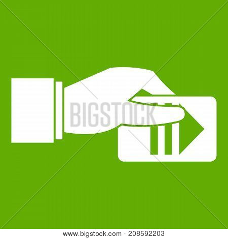 Hand with parking ticket icon white isolated on green background. Vector illustration