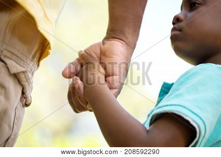 African American loving father guiding his son.