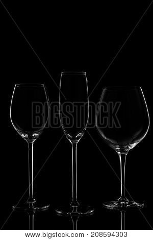 Glassware Selection With Wine, Champagne And Liquour Glasses  On The Dark Background