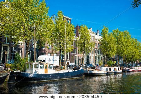 Canal, Boats And Houses In Amsterdam, Netherlands