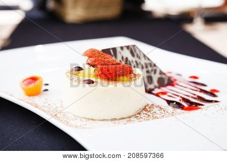 Panna cotta with white chocolate dessert on a plate