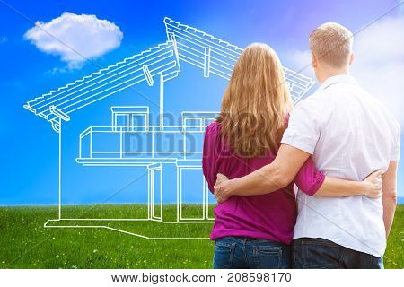 Rear View Of A Loving Couple Looking At Dream House Outdoor