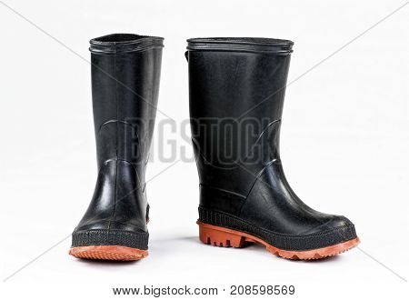 Black rain boots on a white background.