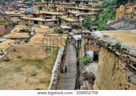 The small village in southwest China with traditional dwellings.