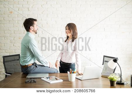 Woman Flirting With Her Coworker
