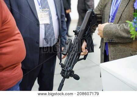 People Are Watching Automatic Weapons At The Exhibition