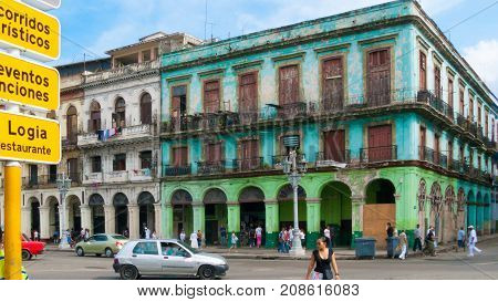 February 2012 Havana - During this time of year tourists walk along the streets of Paseo Marti to appreciate its buildings with old facades