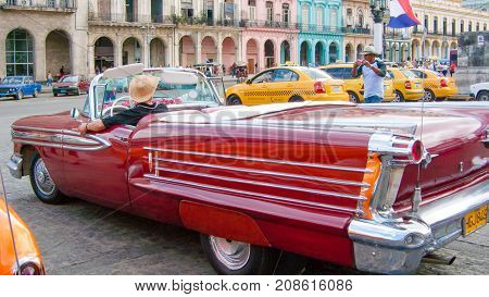 February 2012 Havana - During this time of year these beautifully restored vintage cars bring tourists to visit the streets of the Havana center driven exclusively by their jealous owners
