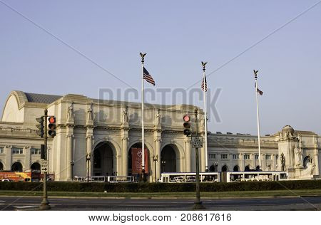 Washington, DC - September 14, 2009 -- Wide view of Union Station with three American flags flying proudly in front of the arched entrance in Washington, on a beautiful sunny day in September.