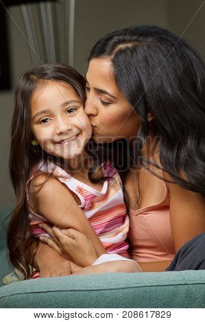 Portrait of a young mother and her daughter.