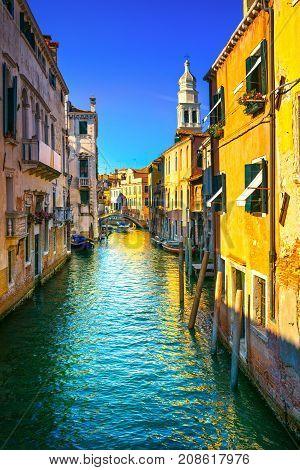 Venice sunset cityscape Rio de la Pleta water canal and Sant Antonin church campanile. Italy Europe.