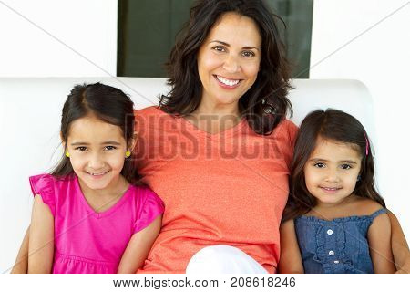 Portrait of a grandmother and her two granddaughters.