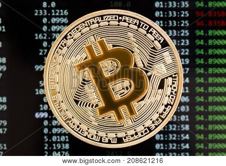 Golden Bitcoin cryptocurrency yellow coin on a circuit board background. High resolution photo.