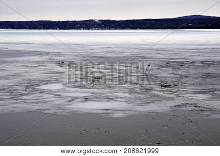 Driftwood is stuck on the ice covering Little Traverse Bay, near Petoskey, Michigan, during March.