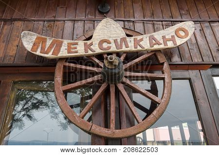 NESEBAR BULGARIA - AUGUST 21 2017: Sign of the Mexican restaurant in a rustic style. Nesebar is an ancient city and one of the major seaside resorts on the Bulgarian Black Sea Coast.