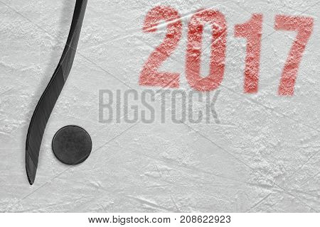 Hockey stick and puck on the ice arena. Concept hockey season 2017