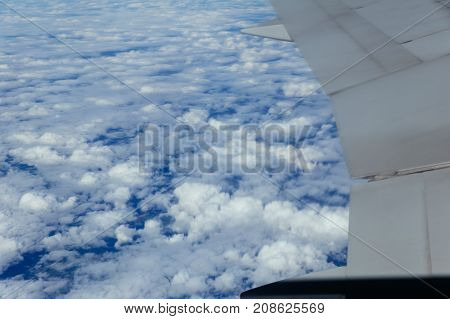 Windows Airplane Flying Above The Clouds In The Sky