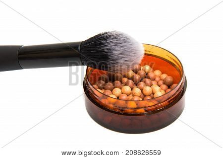 powder with a brush on a white background