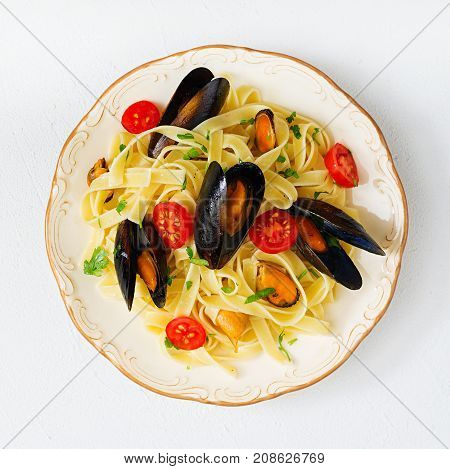 Seafood Fettuccine Pasta With Mussels Over Black Background. Mediterranean Delicacy Food. Flat Lay.