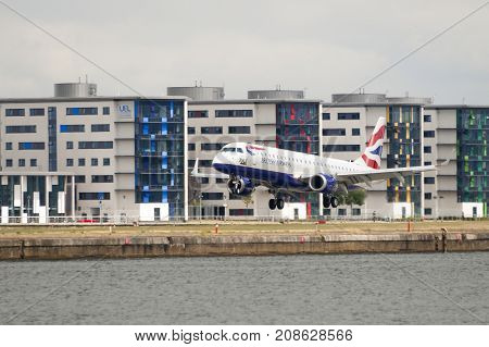 London England - August 2 2013; A British Airways airplane lands at the London City Airport in the borough of Newham