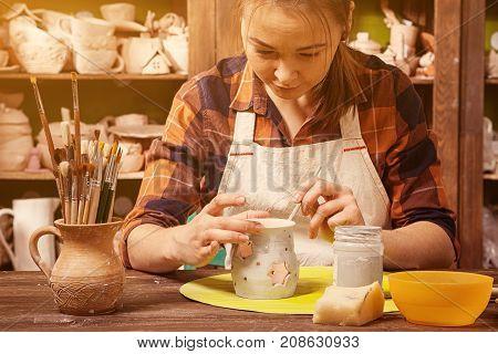 Potter Paints A Clay