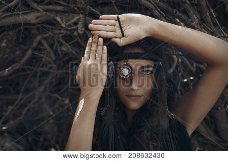 mystery woman close up portrait with roots background