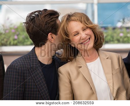 CANNES, FRANCE - MAY 19: Nathalie Baye , Xavier Dolan attend the 'It's Only The End Of The World '  photocall. 69th annual Cannes Film Festival at the Palais des Festivals on May 19, 2016 in Cannes