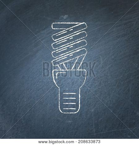 Energy saving light bulb icon sketch on chalkboard. Spiral lamp linear symbol - chalk drawing on blackboard.