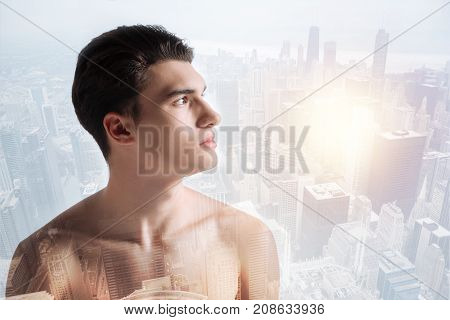 Bright life. Close up of pleasant boy being thoughtful while looking away and expressing calmness