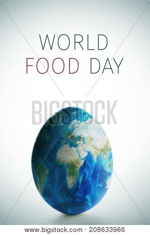 picture of an egg digitally patterned with a world map (furnished by NASA) and the text world food day, on a white background with a slight vignette added