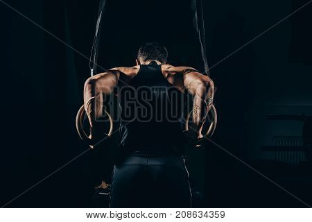 Sportsman Exercising On Gymnastic Rings