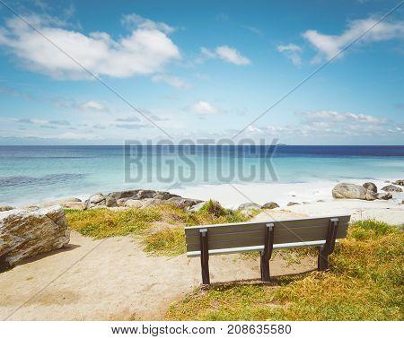 Empty wooden bench facing the Cape Leeuwin sea along the Indian Ocean Augusta Western Australia .