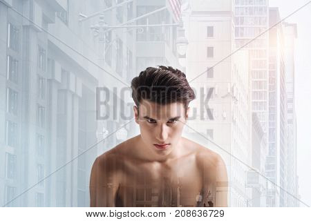 Cold glance. Close up of serious teenager being concentrated while standing in front of you