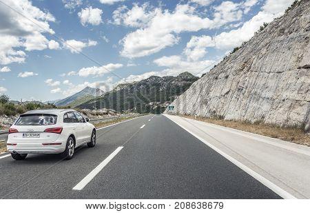 MAKARSKA, CROATIA - JULY 16, 2017: Audi Q5 driving on highway or on the Autobahn among mountain scenery.