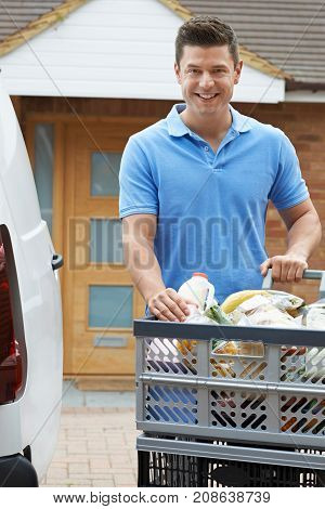 Driver Delivering Online Grocery Order To House