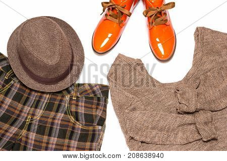 British style outfit. Set of plaid wide leg pants, knit sweater, narrow brim trilby hat, orange patent leather lace up shoes with tapered toes. Fashion women garment in men style