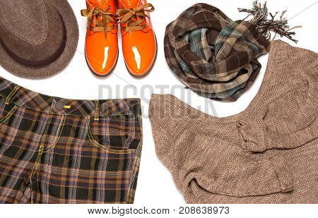 British style outfit. Plaid wide leg pants, knit sweater, narrow brim trilby hat, scarf, orange patent leather lace up shoes with tapered toes. Fashion women garment in men style poster