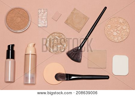 Basic makeup products to achieve even skin tone and complexion: primer, foundation, cosmetic powders with make up brushes and sponges