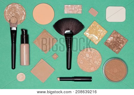 Corrective makeup set: concealer pencil, primer, liquid and cream foundation, various functional types of cosmetic powder with make up brushes and sponges. Flat lay still life