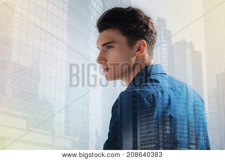 Calm city. Close up of professional model with a stylish haircut looking away while being photographed in profile