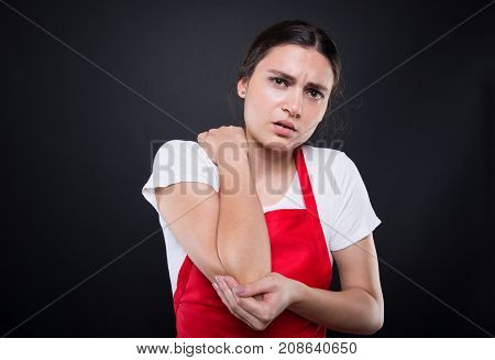 Young Seller With Elbow Pain