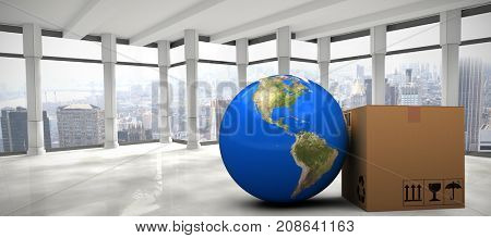 3D image of planet Earth by cardboard box against modern room overlooking city