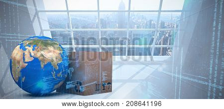 3D planet Earth and cardboard box against white background against room with large window showing city