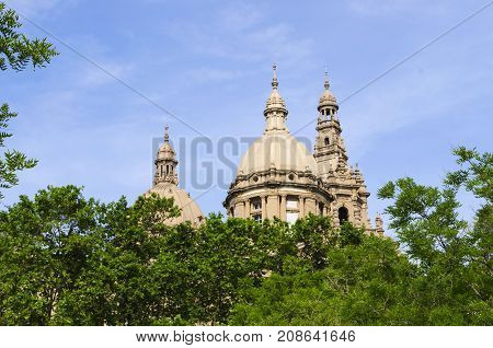 Barcelona Catalonia Spain - JUNE 9 2017 : Domes of The Palau Nacional National Palace situated on the hill of Montju c in Barcelona
